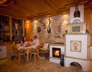 Ein Restaurant oder anderes Speiselokal in der Unterkunft Seehotel Hartung & Ferienappartements