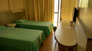 A bed or beds in a room at Barreto Apart Hotel