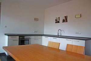 Küche/Küchenzeile in der Unterkunft Runggnerhof