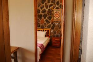 A bed or beds in a room at Sora Lodge Lalibela