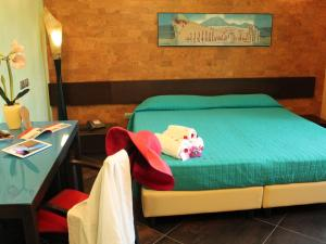 A bed or beds in a room at Pompei Resort