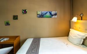 Cama o camas de una habitación en Hotel Des Ardennes