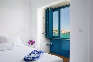 Łóżko lub łóżka w pokoju w obiekcie Little Venice Pieds-à-Terre Mykonos
