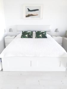 A bed or beds in a room at Airport Residence - Across from Otopeni Airport