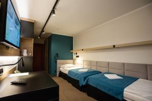 Łóżko lub łóżka w pokoju w obiekcie Ośrodek Zagroń