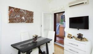 A television and/or entertainment centre at BBHOMEROME - Terrace Navona Penthouse View Luxury
