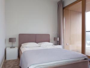 Łóżko lub łóżka w pokoju w obiekcie Chopin Apartments - City