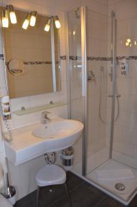 Een badkamer bij Flair Hotel am Rosenhügel