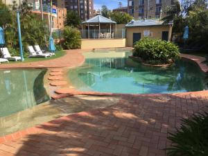 The swimming pool at or near Town Beach Beachcomber Resort