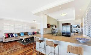 A kitchen or kitchenette at Gold Coast Beachfront Mansion
