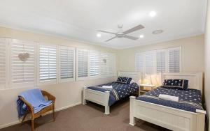 A bed or beds in a room at Gold Coast Beachfront Mansion
