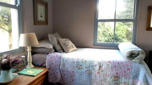 A bed or beds in a room at Little Fields Country House