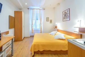 Letto o letti in una camera di Studio Apartments Stradun