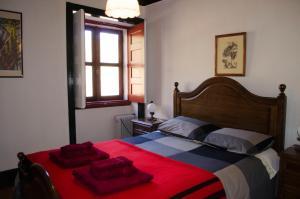 Uma cama ou camas num quarto em Casa da Sicó