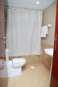 A bathroom at Safari Hotel Apartments - Tabasum Group