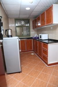 A kitchen or kitchenette at Safari Hotel Apartments - Tabasum Group
