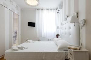 A bed or beds in a room at Domus Karalis