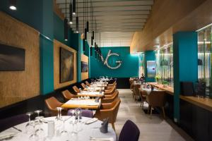 A restaurant or other place to eat at Vanilla Garden Boutique Hotel - Adults Only