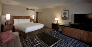 A bed or beds in a room at Hilton Palm Springs