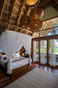 A bed or beds in a room at Ahau Tulum