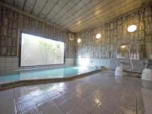 The swimming pool at or near Hotel Route-Inn Court Fujioka