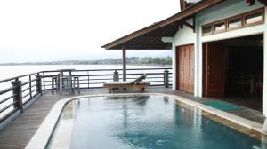 The swimming pool at or near Bombora Medewi Wavelodge
