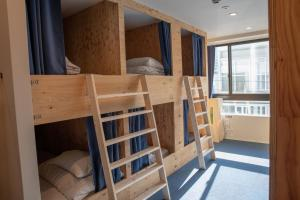 A bunk bed or bunk beds in a room at Guesthouse Akicafe Inn