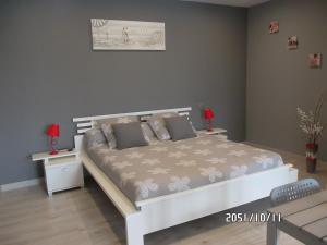 Un ou plusieurs lits dans un hébergement de l'établissement Chambres d'Hôtes Les Sables