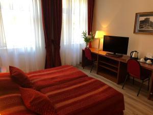 Un ou plusieurs lits dans un hébergement de l'établissement Ariston & Ariston Patio Hotel