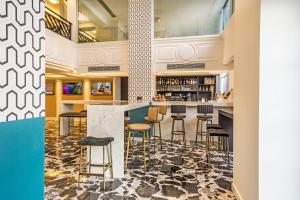 The lounge or bar area at Airotel Stratos Vassilikos Hotel