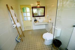 A bathroom at Mr. Charles River View Lodge
