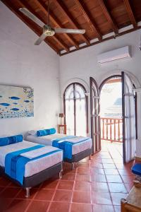 A bed or beds in a room at Cartagena Legends