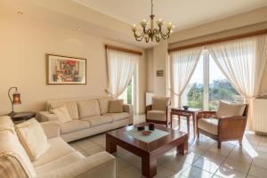 A seating area at Olive Tree Villa Kalamata