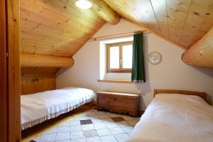 Ein Bett oder Betten in einem Zimmer der Unterkunft Bed and Breakfast da Käthy Agriturismo