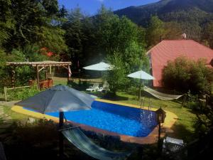 A view of the pool at La Cabaña de Piedra or nearby