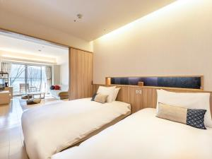 Un ou plusieurs lits dans un hébergement de l'établissement Hakone Ashinoko Hanaori