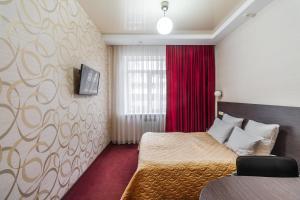 Кровать или кровати в номере Веструм Отель