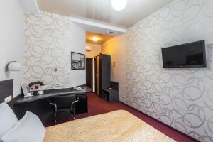 Телевизор и/или развлекательный центр в Веструм Отель