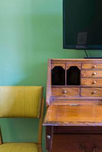 TV o dispositivi per l'intrattenimento presso Frími Boutique Rooms b&b