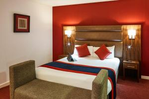 A bed or beds in a room at Mercure Newbury West Grange Hotel