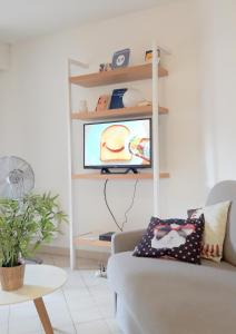 A seating area at Appartement Eglantines