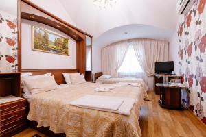 Кровать или кровати в номере Отель Империал