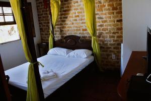Cama ou camas em um quarto em Pousada La Maison du Baron