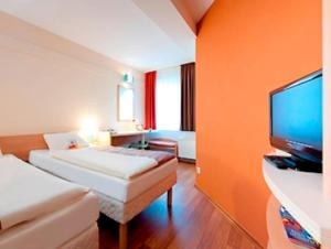 A bed or beds in a room at ibis Bonn