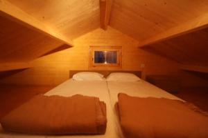 A bed or beds in a room at Naturwaterpark - Parque de Diversões do Douro