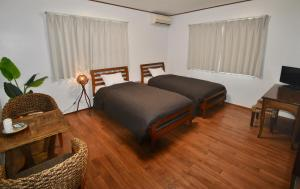 A bed or beds in a room at Inn By The Sea Kamakura
