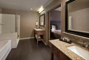 A bathroom at Jamaica Bay Inn Marina Del Rey Tapestry Collection by Hilton