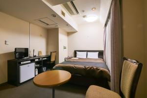 A television and/or entertainment center at Hotel Continental Fuchu