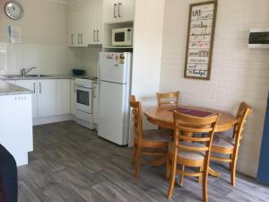 A kitchen or kitchenette at Calendo Apartments