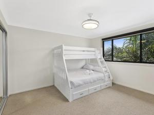 A bunk bed or bunk beds in a room at North Entrance Beach House